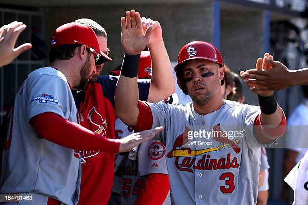 Carlos Beltran of the St Louis Cardinals celebrates in the dugout after scoring a run in the third inning against the Los Angeles Dodgers in Game...