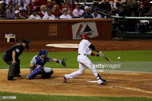 Carlos Beltran of the St Louis Cardinals hits a two RBI double in the third inning against the Los Angeles Dodgers during Game One of the National...