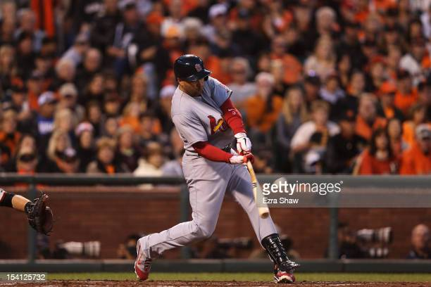 Carlos Beltran of the St Louis Cardinals hits a tworun home run in the fourth inning during Game One of the National League Championship Series...