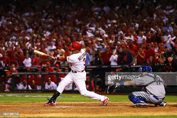 Carlos Beltran of the St Louis Cardinals hits the game winning run in the 13th inning against the Los Angeles Dodgers during Game One of the National...