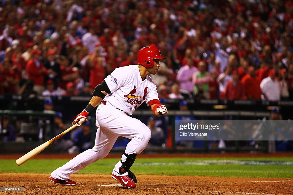Carlos Beltran #3 of the St. Louis Cardinals hits the game winning run in the 13th inning against the Los Angeles Dodgers during Game One of the National League Championship Series at Busch Stadium on October 11, 2013 in St Louis, Missouri.