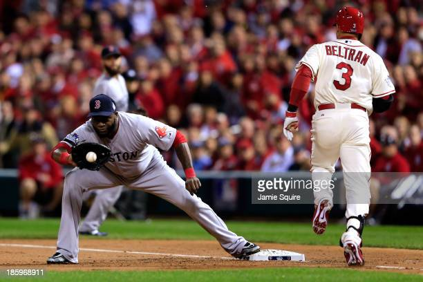 Carlos Beltran of the St Louis Cardinals is out on a sacrafice moving Matt Carpenter to second in the first inning as David Ortiz of the Boston Red...
