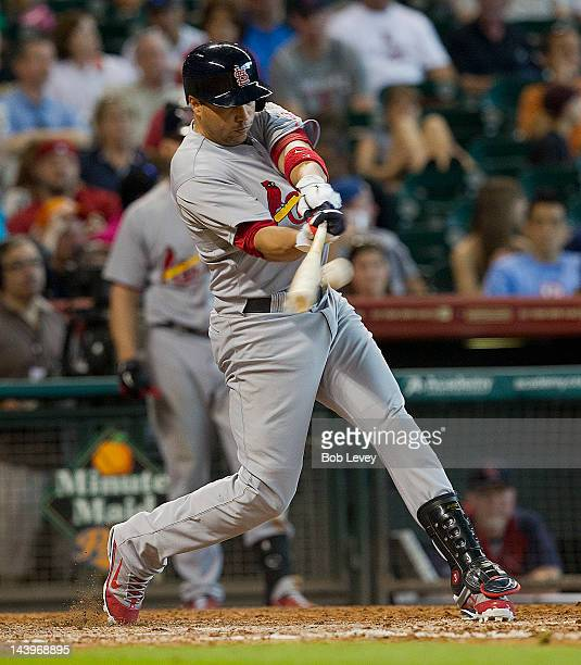 Carlos Beltran of the St Louis Cardinals singles in the eighth inning against the Houston Astros on May 6 2012 at Minute Maid Park in Houston Texas...