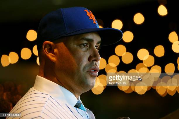 Carlos Beltran talks to the media after being introduced by as the manager of the New York Mets during a press conference at Citi Field on November...