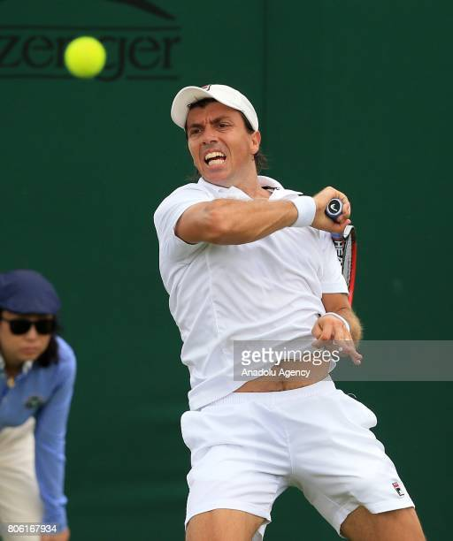 Carlos Berlocq of Argentina in action against Nikoloz Basilashvili of Georgia on day one of the 2017 Wimbledon Championships at the All England Lawn...
