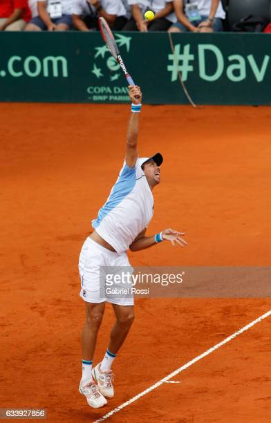 Carlos Berlocq of Argentina serves during a singles match between Carlos Berlocq and Paolo Lorenzi as part of day 3 of the Davis Cup 1st round match...
