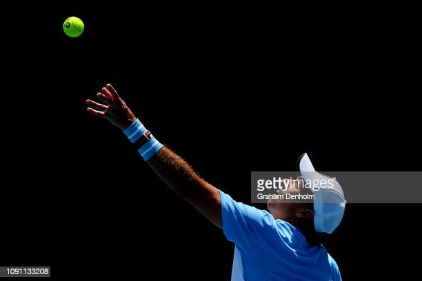 Carlos Berlocq of Argentina serves in his match against Dustin Brown of Germany during day one of Qualifying for the 2019 Australian Open at...
