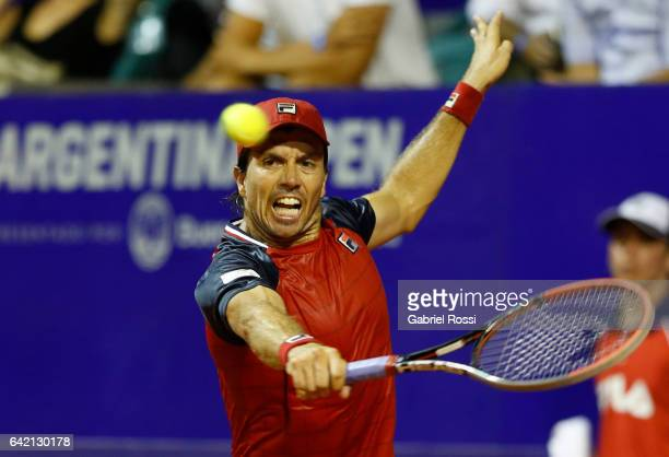 Carlos Berlocq of Argentina takes a backhand shot during a second round match between David Ferrer of Spain and Carlos Berlocq of Argentina as part...