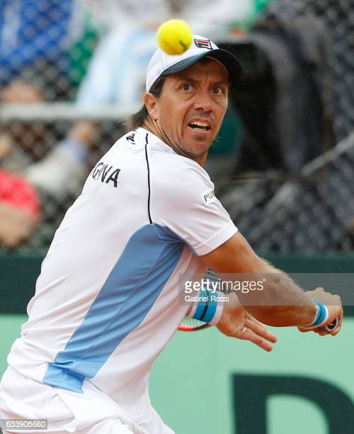 Carlos Berlocq of Argentina takes a backhand shot during a singles match between Carlos Berlocq and Paolo Lorenzi as part of day 3 of the Davis Cup...