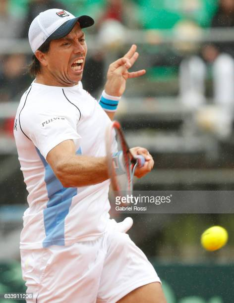 Carlos Berlocq of Argentina takes a forehand shot during a singles match between Carlos Berlocq and Paolo Lorenzi as part of day 3 of the Davis Cup...