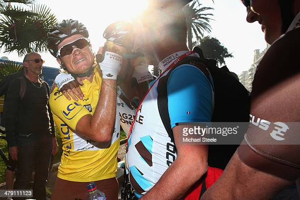 Carlos Betancur Gomez of Colombia and AG2R La Mondiale is congratulated by team mates after claiming overall race victory and the yellow jersey after...