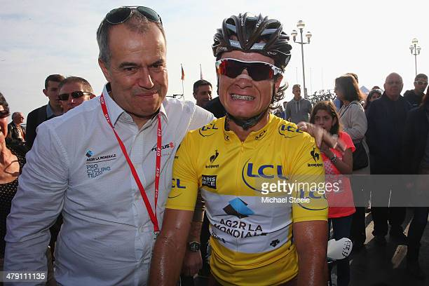 Carlos Betancur Gomez of Colombia and AG2R La Mondiale is congratulated by Vincent Lavenu the manager of AG2R La Mondiale after claiming overall race...