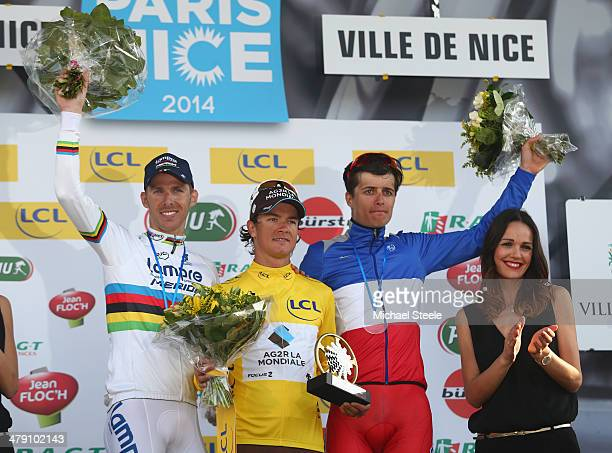 Carlos Betancur Gomez of Colombia and AGR La Mondiale overall winner of the race and yellow jersey alongside second placef Rui Costa of Portugal and...
