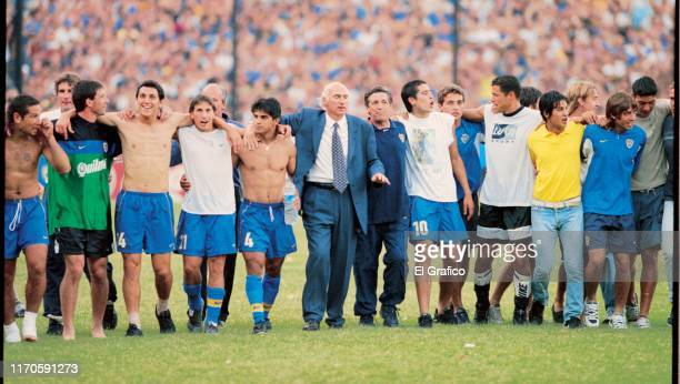 Carlos Bianchi coach of Boca Juniors celebrates with his players winning the Copa Libertadores 2001 at Alberto J Armando Stadium on August 2001 in...