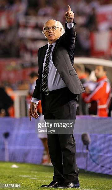 Carlos Bianchi coach of Boca Juniors gestures during a match between River Plate and Boca Juniors as part of the Torneo Inicial 2013 at Monumental...
