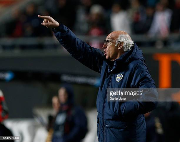 Carlos Bianchi coach of Boca Juniors gives instructions to his players during a match between Estudiantes and Boca Juniors as part of forth round of...