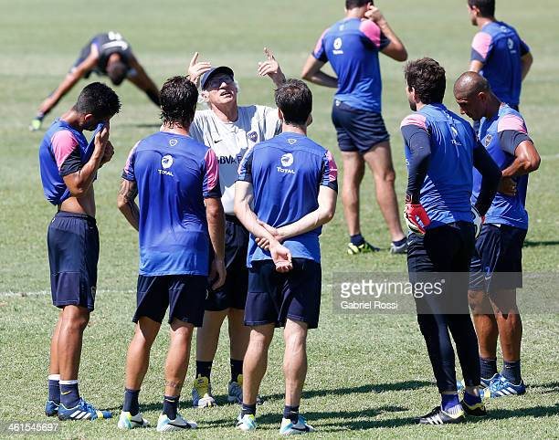 Carlos Bianchi coach of Boca Juniors gives instructions to his players during a Boca Juniors training session at Casa Amarilla on January 09 2014 in...