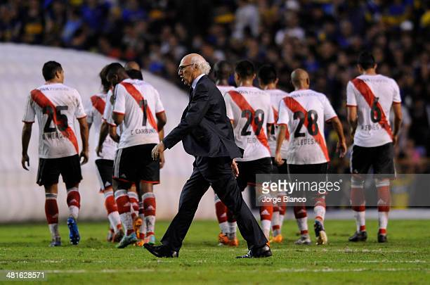 Carlos Bianchi coach of Boca Juniors leaves the field at half time during a match between Boca Juniors and River Plate as part of 10th round of...