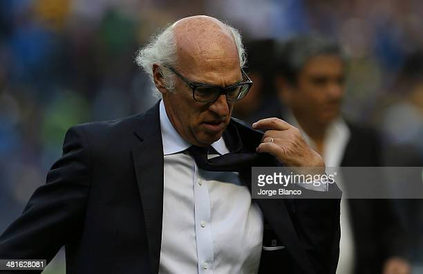 Carlos Bianchi coach of Boca Juniors looks on during a match between Boca Juniors and River Plate as part of 10th round of Torneo Final 2014 at...