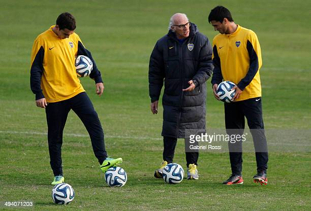 Carlos Bianchi head coach of Boca Juniors gives instructions to his players during a training session at Casa Amarilla on May 27 2014 in Buenos Aires...