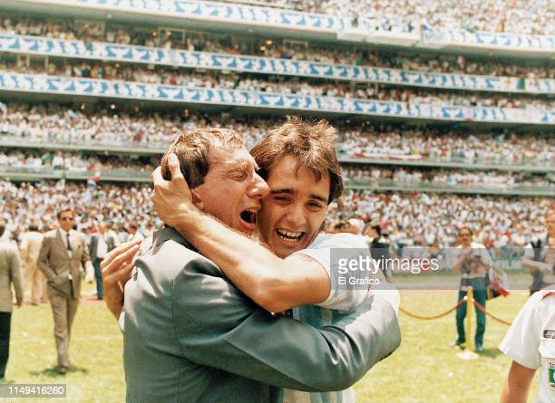 Carlos Bilardo coach of Argentina cries with his player Pedro Pasculli after defeating West Germany 32 during the 1986 FIFA World Cup Final match at...