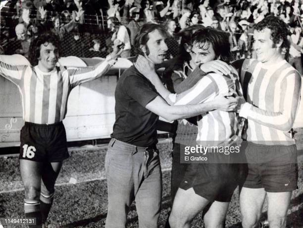 Carlos Bilardo coach of Estudiantes celebrates with his players during a match on May 07 1975 in La Plata Argentina