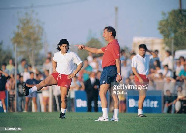 Carlos Bilardo coach of Sevilla gives instructions to his player Diego Maradona circa 1992 in Sevilla Spain