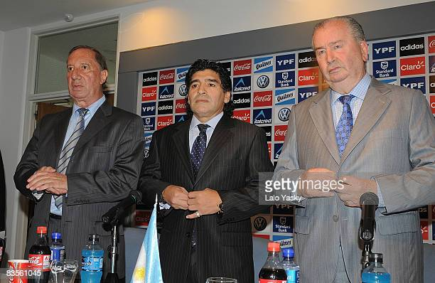 Carlos Bilardo Diego Maradona and Julio Grondona pose for photographers at the presentation of Diego Maradona as new Argentina«s football coach at...