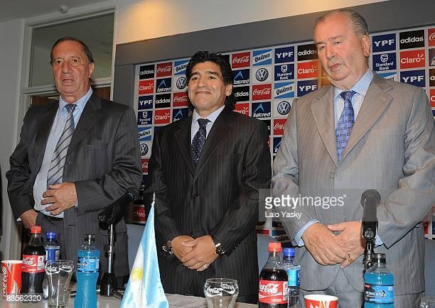 Carlos Bilardo Diego Maradona and Julio Grondona pose for photographers at the presentation of Diego Maradona as new Argentina's football coach at...