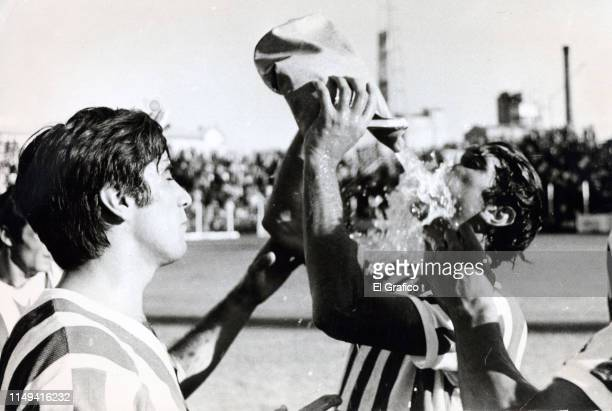 Carlos Bilardo of Estudiantes drinks water next to his teammate Carlos Pachame during a match on March 03 1968 in La Plata Argentina