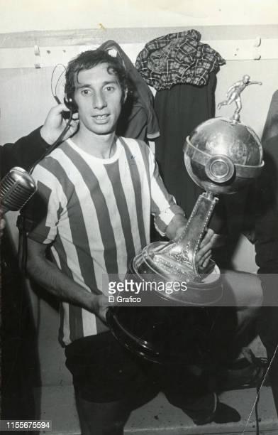 Carlos Bilardo of Estudiantes poses with the trophy of the Libertadores Cup 1969 on May 21 1969 in La Plata Argentina