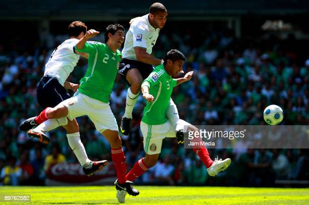Carlos Bocanegra and Oguchialu Onyegu of USA vies for the ball with Jonny Magallon and Carlos Salcido of Mexico during their FIFA 2010 World Cup...