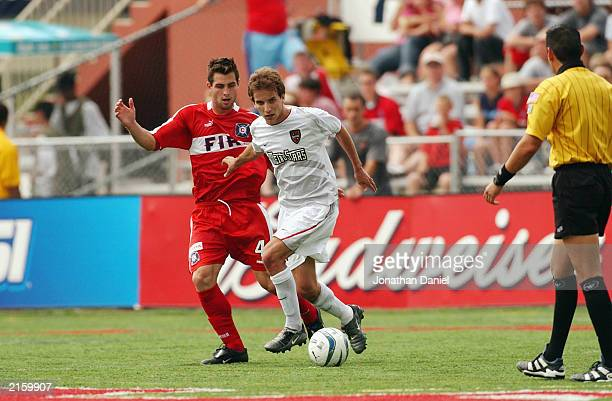 Carlos Bocanegra of the Chicago Fire defends Mike Magee of the NY/NJ MetroStars during their MLS game on June 28 2003 at Cardinal Stadium in...