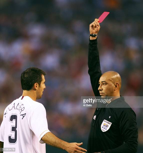 Carlos Bocanegra of the USA receives a red card for elbowing Hector Gonzalez of Venezuela in the head during their match on May 26 2006 at Cleveland...