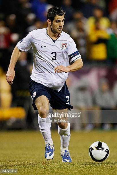 Carlos Bocanegra of USA dribbles the ball against Mexico during a FIFA 2010 World Cup qualifying match in the CONCACAF region on February 11 2009 at...