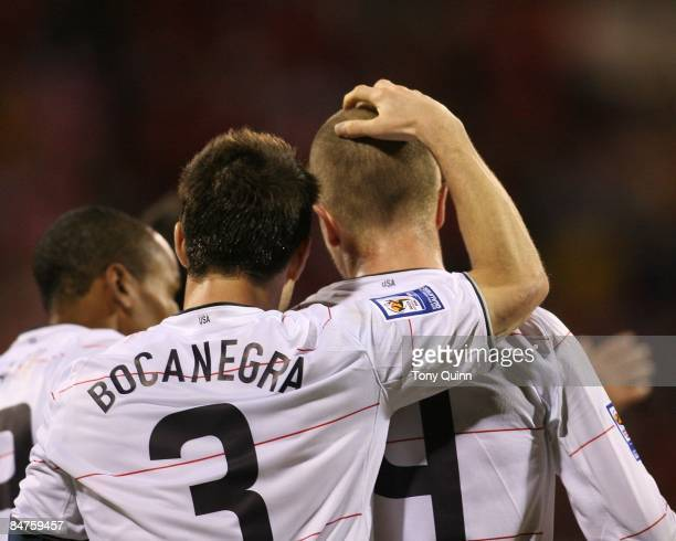 Carlos Bocanegra with Michael Bradley Of USA after Bradley had scored his second goal during a FIFA 2010 World Cup qualifying match against Mexico in...