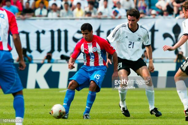 Carlos BONET and Christoph METZELDER during the FIFA World Cup match between Germany and Paraguay on June 15 2002 in Jeju Stadium South Korea