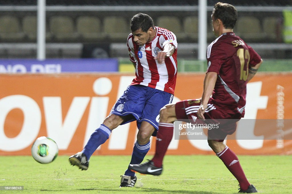 Carlos Bonet kicks the ball during a match between Venezuela and Paraguay as part of the 17th round of the South American Qualifiers at Pueblo Nuevo Stadium on October 11, 2013 in San Cristobal, Venezuela.
