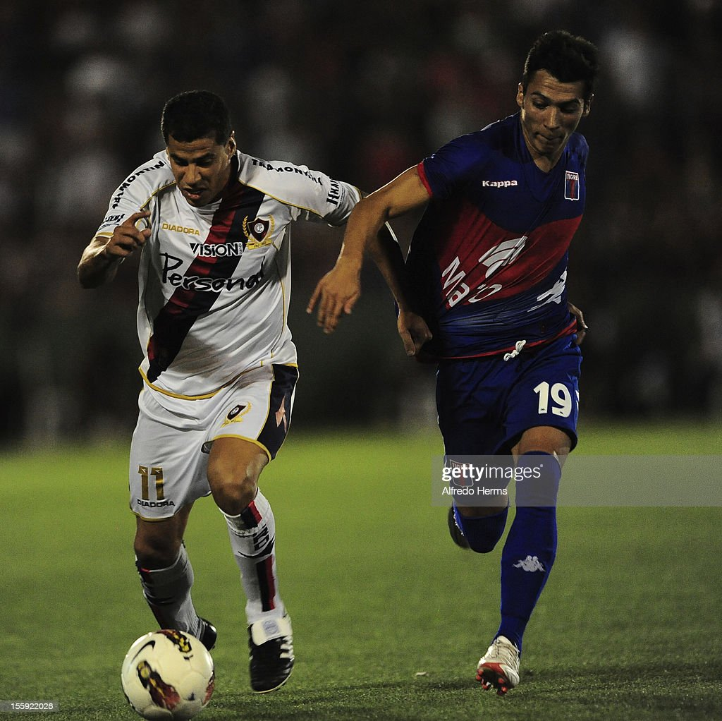 Carlos Bonet of Cerro Porte–o fights for the ball during the match between Tigre from Argentina and Cerro Porte–o from Paraguay as part of the quarterfinals of Copa Sudamericana 2012 at Tigre stadium on November 08, 2012 in Tigre, Buenos Aires. Argentina