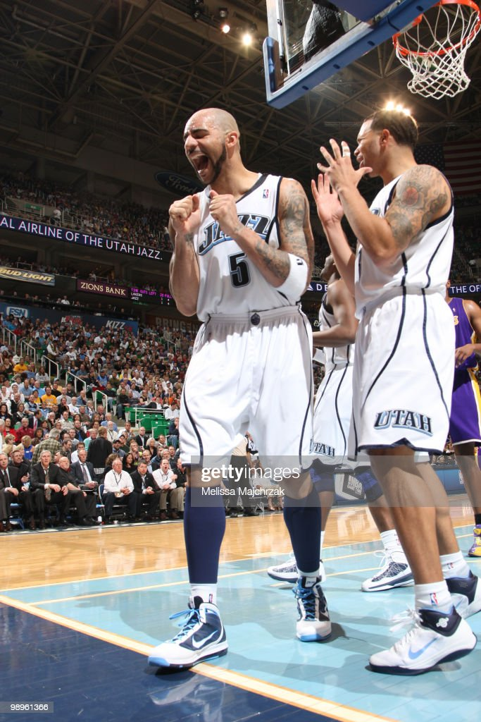 Carlos Boozer #5 and Deron Williams #8 of the Utah Jazz react to a call during a game against the Los Angeles Lakers in Game Four of the Western Conference Semifinals during the 2010 NBA Playoffs on May 10, 2010 at the EnergySolutions Arena in Salt Lake City, Utah.