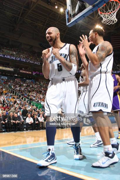 Carlos Boozer and Deron Williams of the Utah Jazz react to a call during a game against the Los Angeles Lakers in Game Four of the Western Conference...