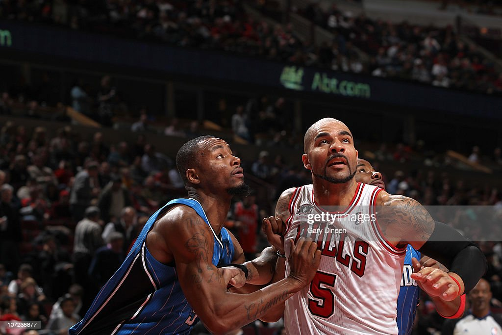 Carlos Boozer #5 of the Chicago Bulls battles for position with Rashard Lewis #9 of the Orlando Magic during the NBA game on December 1, 2010 at the United Center in Chicago, Illinois.