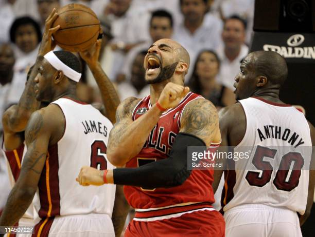 Carlos Boozer of the Chicago Bulls celebrates in the third quarter during Game 3 of the NBA Eastern Conference Finals at the American Airlines Arena...