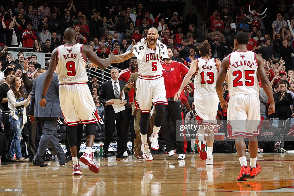 Carlos Boozer #5 of the Chicago Bulls celebrates with teammates Luol Deng #9, Joakim Noah #13 and Marquis Teague #25 during the game against the Brooklyn Nets on December 15, 2012 at the United Center in Chicago, Illinois.