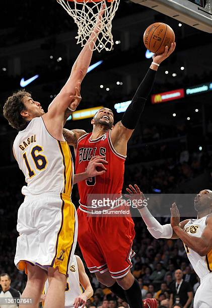Carlos Boozer of the Chicago Bulls drives to the basket against Pao Gasol of the Los Angeles Lakers at Staples Center on December 25 2011 in Los...