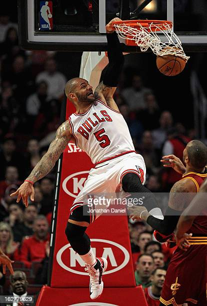 Carlos Boozer of the Chicago Bulls dunbks against the Cleveland Cavaliers at the United Center on February 26 2013 in Chicago Illinois NOTE TO USER...