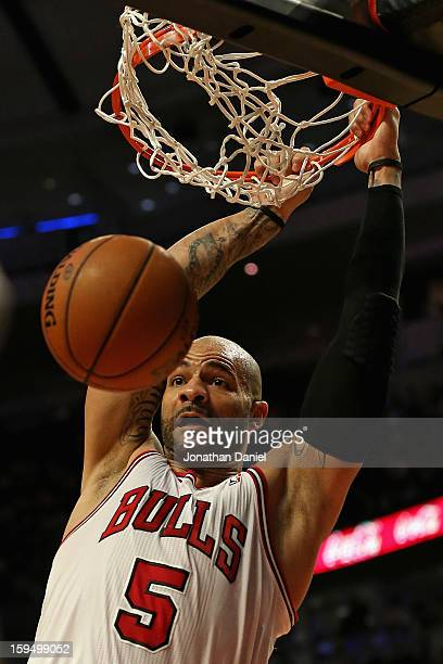 Carlos Boozer of the Chicago Bulls dunks against the Los Angeles Clippers at the United Center on December 11 2012 in Chicago Illinois The Clippers...