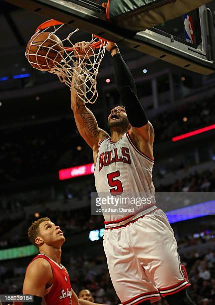 Carlos Boozer of the Chicago Bulls dunks over Blake Griffin of the Los Angeles Clippers on his way to a gamehigh 24 points at the United Center on...