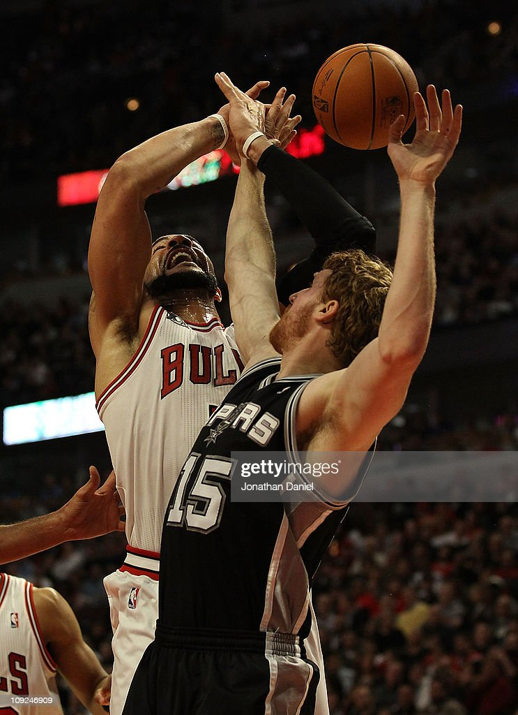 Carlos Boozer #5 of the Chicago Bulls is fouled while shooting by Matt Bonner #15 of the San Antonio Spurs at the United Center on February 17, 2011 in Chicago, Illinois. The Bulls defeated the Spurs 109-99.