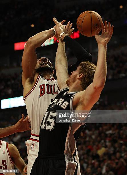 Carlos Boozer of the Chicago Bulls is fouled while shooting by Matt Bonner of the San Antonio Spurs at the United Center on February 17 2011 in...